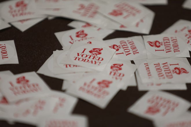 """Stickers of """" I Voted Today"""" lie in a pile for voters on Edgerton Recreation Center on Oct. 31, 2020"""