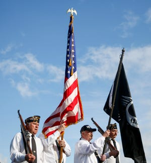 Color guard members present the flags during Stanton Rickey's 100th birthday parade on Friday, Oct. 30, 2020 in Dallas, Oregon.