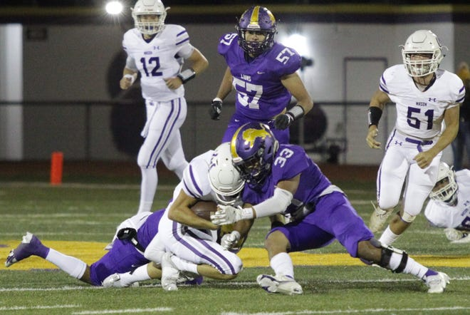 Ozona High School's Carlos Cantu (33) makes a tackle against Mason during a District 14-2A Division I football game Friday, Oct. 30, 2020, in Ozona.