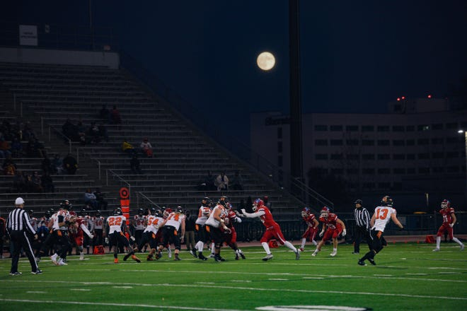 A nearly full moon rises over Washington and Lincoln football on Friday, October 30, in the Class 11AAA playoffs at Howard Wood Field in Sioux Falls.