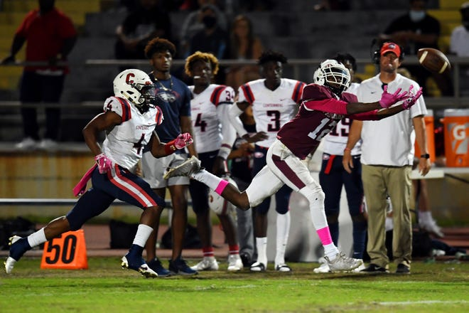 Vandrevious Jacobs, shown here reaching for a pass against St. Lucie West Centennial in 2020, was offered by Florida State on Thursday.