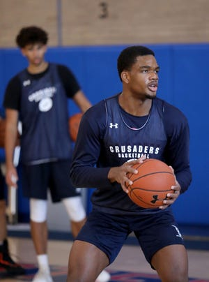 Archbishop Stepinac senior Malcolm Chimezie goes through some drills during a virtual basketball combine/workout at the school Oct. 31, 2020. The streamed workout was for college coaches and scouts who can't attend due to COVID-19.