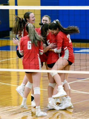 Sheridan players celebrate a 25-16, 23-25, 25-17, 25-22 win against Circleville in a Division II district final on Saturday at Chillicothe Southeastern. Sheridan, now 25-1, reached the regional for the third straight year.