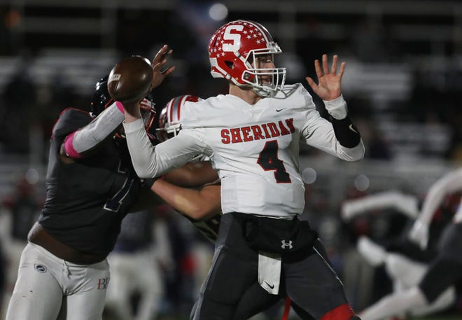 Sheridan's Josh O'Ryan passes against Hartley. The Generals struggled to get their offense going in a 10-6 loss on Friday night.