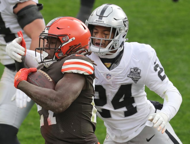 Browns running back Kareem Hunt is taken down by Las Vegas Raiders safety Jonathan Abram during the second quarter Sunday at FirstEnergy Stadium in Cleveland.
