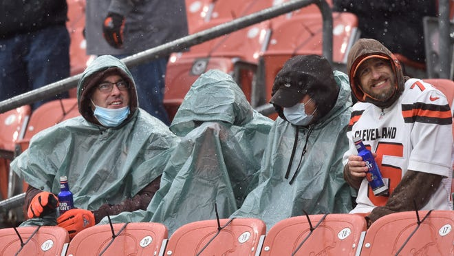 Cleveland Browns fans watch during the first half of an NFL football game against the Las Vegas Raiders, Sunday, Nov. 1, 2020, in Cleveland. (AP Photo/David Richard)