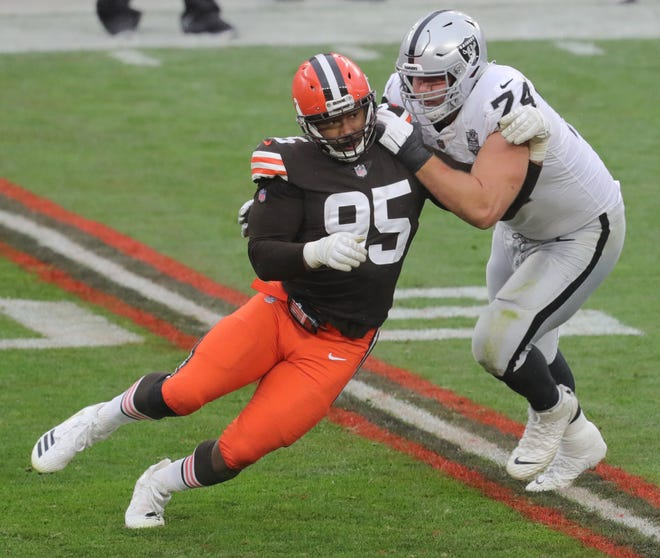 Browns defensive end Myles Garrett gets around Las Vegas Raiders tackle Colton Miller during the second quarter Sunday in Cleveland.