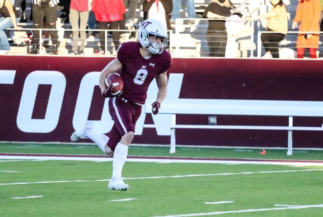 West Texas A&M's Chase Sjoka heads up the field after catching a pass from Nick Gerber for a 76-yard touchdown last season against North American University at Buffalo Stadium.
