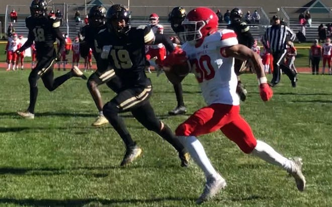 Rancocas Valley running back A.J. Hugee is off on a 31-yard run on Saturday with Burlington Township's Anthony Johnson in pursuit.