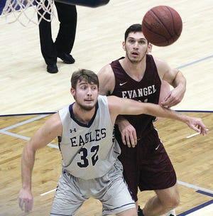 Veteran Oklahoma Wesleyan University forward Janson Lietzke, left, fends off an Evangel player while preparing to go after a rebound Saturday.