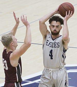 Oklahoma Wesleyan University's Lense Ramey, right, surveys his passing options during Saturday's home battle against Evangel.