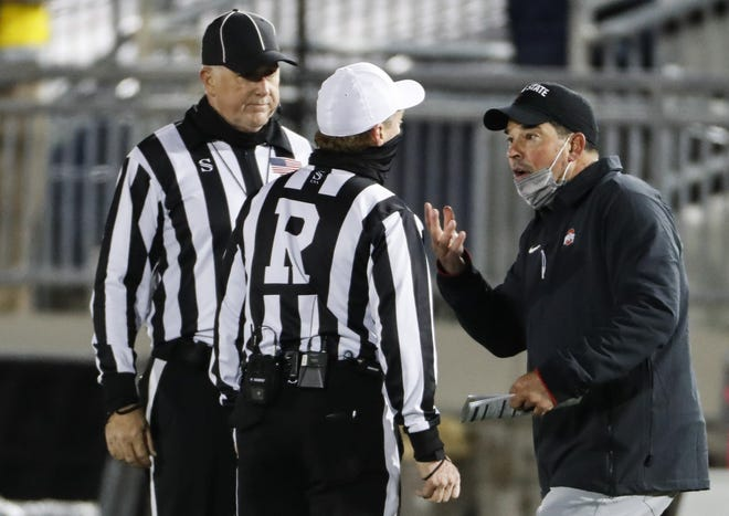 Ohio State coach Ryan Day argues with officials after his team was pulled from the locker room because replay indicated OSU's Justin Fields hadn't run out the clock before halftime.