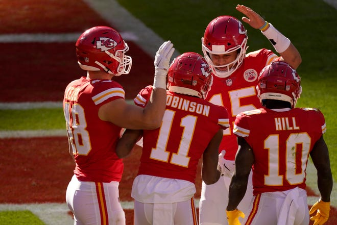 Kansas City Chiefs' Nick Keizer (48), Demarcus Robinson (11), Tyreek Hill (10) and Patrick Mahomes (15), celebrate a touchdown scored on a catch by Robinson in the second half against the New York Jets on Sunday in Kansas City.
