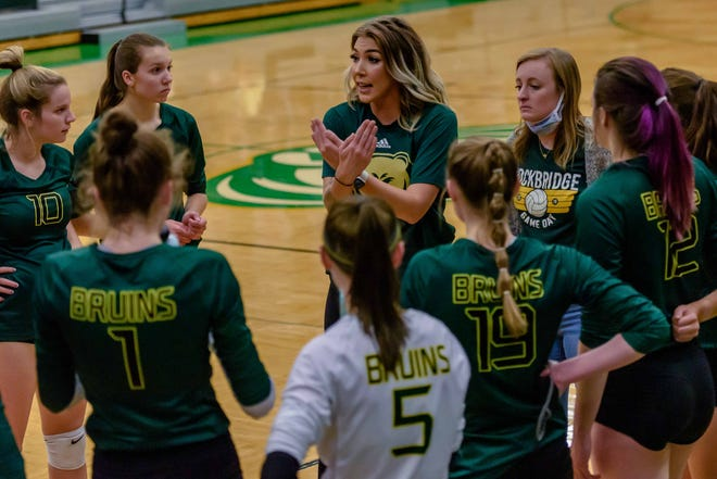 Rock Bridge head volleyball coach Nicole Murphy speaks with her team during a match against Helias on Oct. 19 at Rock Bridge High School.