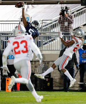 Penn State Nittany Lions receiver Jahan Dotson makes a one-handed touchdown catch in front of Ohio State cornerback Shaun Wade in the Buckeyes' 38-25 victory last Saturday.
