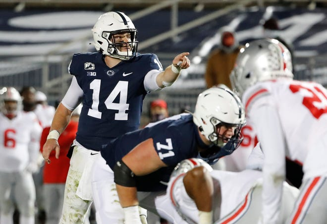 Penn State quarterback Sean Clifford (14) calls a play at the line of scrimmage during the fourth quarter against Ohio State at Beaver Stadium in University Park, Pa., on Oct. 31. The Nittany Lions look to avoid an 0-3 start when they visit Maryland on Saturday.