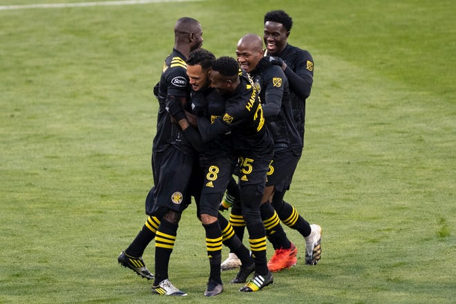 The Columbus Crew celebrates a goal from midfielder Artur in the 37th minute of Sunday's game at Mapfre Stadium against Philadelphia Union. The Crew won 2-1.