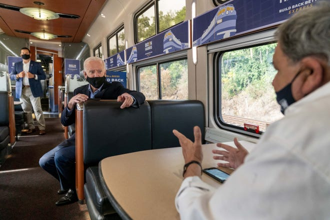 Former Vice President Joe Biden speaks with United Steelworkers Union President Thomas Conway, right, aboard a chartered Amtrak train Sept. 30 that started in Cleveland the day after the Democrat's debate with President Donald Trump.