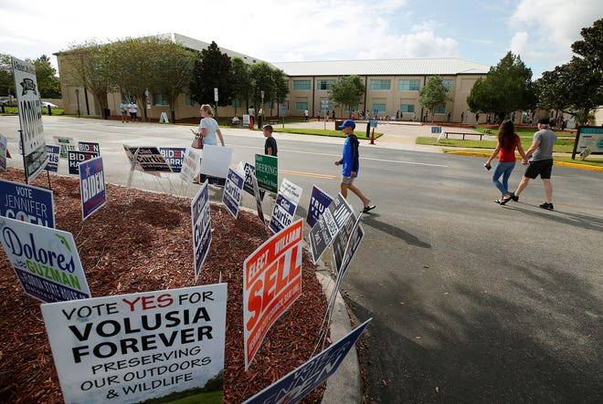 Voters cast their ballot at Deltona City Commission Chambers in Deltona on the last day of early voting, Sunday, Nov. 1, 2020.