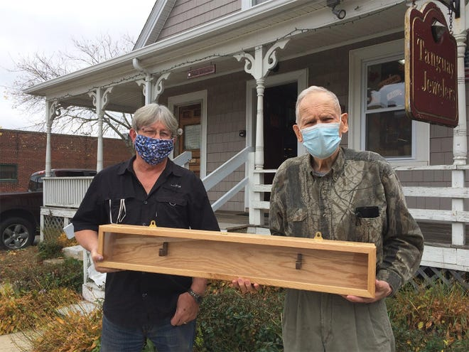 Brian Tanguay, left, gives Gerry Gariepy a new display case for Phillipston's Boston Post Cane. [Courtesy photo]