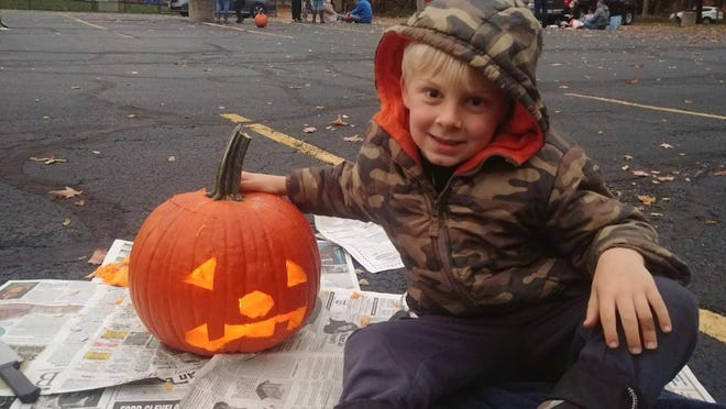 Ben Kercher is pictured with his jack-o-lantern at a pumpkin carving event recently hosted by Lord of Life Lutheran Church.