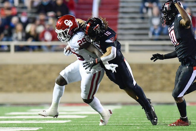 Texas Tech safety Thomas Leggett tackles Oklahoma running Rhamondre Stevenson during the Red Raiders' most recent home game two weeks ago. Tech hosts Baylor on Saturday in the Bears' first visit to Lubbock since 2008.