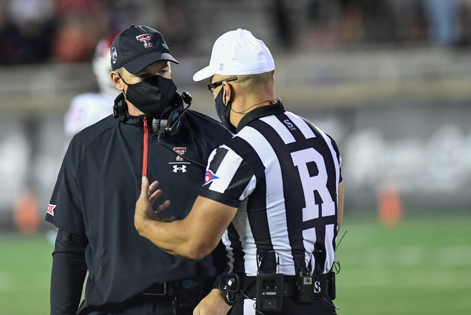 Texas Tech coach Matt Wells confers with referee Scott Campbell during the Red Raiders Oct. 31 loss to Oklahoma. The Red Raiders have lost five of their past six games, falling to 2-5 with a 1-5 record in the Big 12.