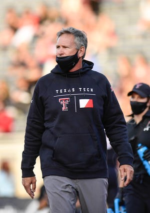 Texas Tech defensive coordinator Keith Patterson watches over his unit during pre-game warm-up Saturday night at Jones AT&T Stadium. The Red Raiders lost starting defensive tackle Tony Bradford to a leg injury during pre-game, leaving Tech without two of its regular starters in the front seven.