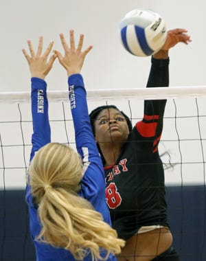Victory Christian's Damyah Joyner puts down a kill over a Geneva blocker on Saturday afternoon in the Class 2A, Region 2 final.