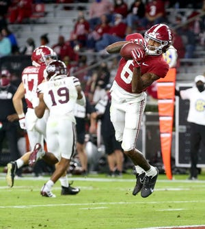 Alabama wide receiver DeVonta Smith (6) catches a touchdown pass during Saturday's game in Tuscaloosa, Ala.
