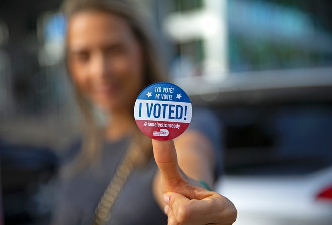 """Sucel Peleg poses with her """"I Voted"""" sticker after casting her ballot during early voting for the general election on Friday in Aventura."""