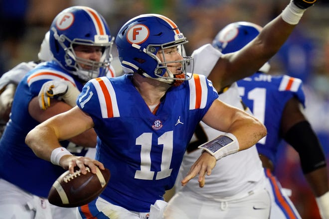 Florida quarterback Kyle Trask (11) looks for a receiver during the first half Saturday against Missouri in Gainesville.