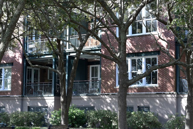 """This photo shows the outside of a Charleston, S.C., condominium belonging to Eugene Zurlo on Monday last month. The Trump administration recently gave the longtime Republican political donor seed money to test a possible COVID-19-fighting blood plasma technology, noting Zurlo's """"manufacturing facilities"""" in Charleston. An AP investigation found no manufacturing facilities. The company operates out of Zurlo's condo."""