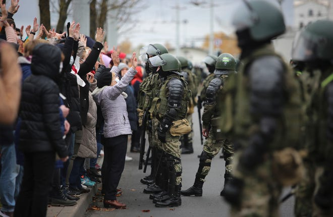 People argue with police officers during an opposition rally to protest the official presidential election results in Minsk, Belarus, on Sunday. Nearly three months after Belarus' authoritarian president's re-election to a sixth term in a vote widely seen as rigged, the continuing rallies have cast an unprecedented challenge to his 26-year rule.