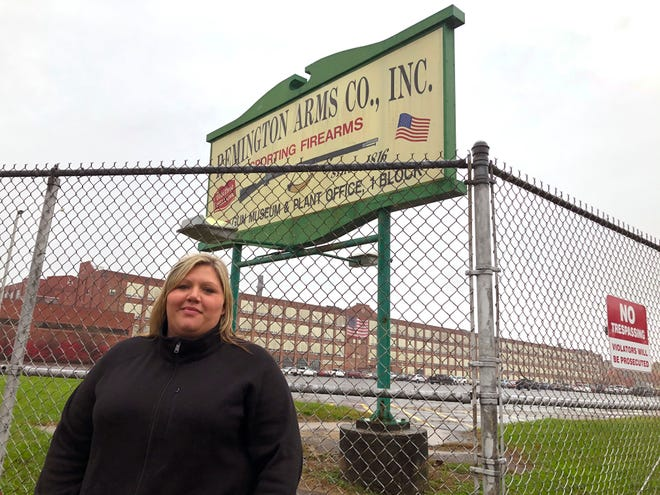 Jacquie Sweeney stands outside the Remington firearms factory in Ilion, N.Y., last month. Jacquie Sweeney and her husband were among almost 600 workers fired by the company recently, a few months after Remington Outdoor Co. sought bankruptcy protection for the second time in two years. Successful bidders for the idled plant in bankruptcy proceedings have said they plan to restart at least some production, though details remain scarce.