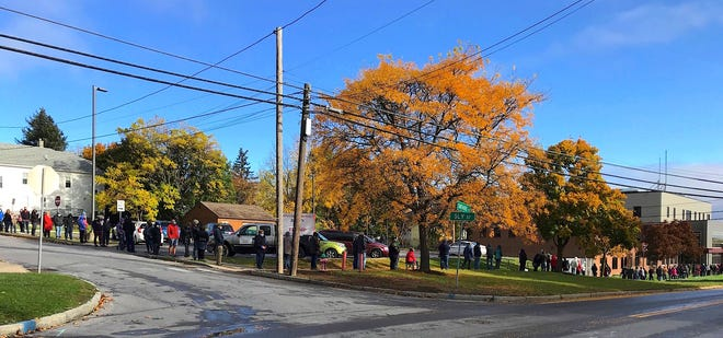 Lines wrap around the block outside the Ontario County Board of Elections on the first day of early voting 2020, Oct. 24.
