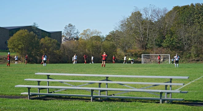 The stands are empty as Rogers takes on Providence Country Day in a girls soccer game Saturday in Newport. Gov. Gina Raimondo announced Friday crowds at high school games are not permitted for two weeks because of rising COVID numbers.