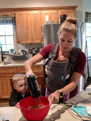 Melissa Obernesser bakes with her two children in the kitchen.
