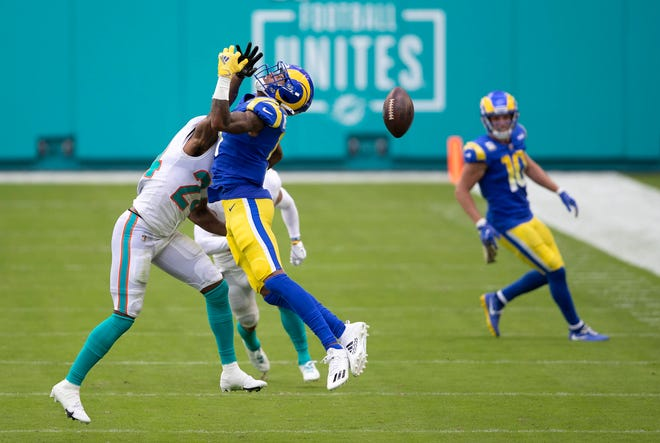 Dolphins cornerback Byron Jones, breaking up a pass intended for Josh Reynolds of the Rams, is part of a committee of Dolphins players united behind encouraging voter turnout this Election Day.