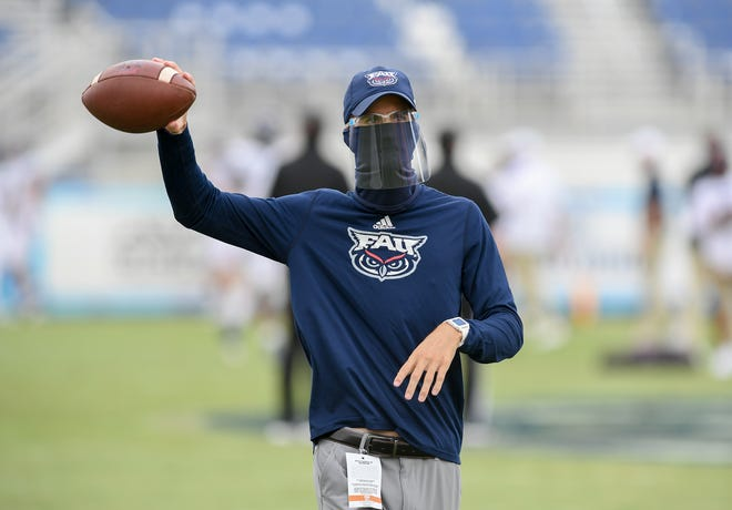 Florida Atlantic Owls co-offensive coordinator Clint Trickett warms up before a 24-3 win over the Texas-San Antonio Roadrunners in Boca Raton on October 31, 2020. [JEFF ROMANCE/palmbeachpost.com]
