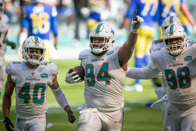 Dolphins defensive tackle Christian Wilkins celebrates a interception against the Los Angeles Rams.