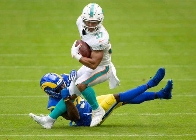 Dolphins running back Myles Gaskin is stopped by Los Angeles Rams defensive back Darious Williams.