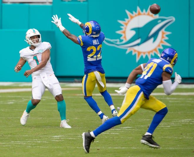 Miami Dolphins quarterback Tua Tagovailoa (1) unloads a pass das he is pressured by Los Angeles Rams cornerback Troy Hill (22) at Hard Rock Stadium in Miami Gardens, November 1, 2020.  (ALLEN EYESTONE / THE PALM BEACH POST)