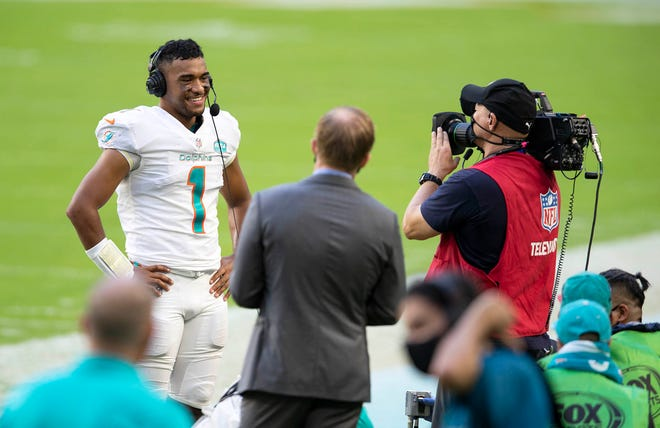 Miami Dolphins quarterback Tua Tagovailoa (1) does an interview after win over the Los Angeles Rams at Hard Rock Stadium in Miami Gardens, November 1, 2020.  (ALLEN EYESTONE / THE PALM BEACH POST)