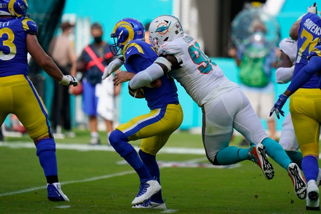 Miami Dolphins defensive end Shaq Lawson (90) sacks Los Angeles Rams quarterback Jared Goff (16), during the first half of an NFL football game, Sunday, Nov. 1, 2020, in Miami Gardens, Fla.
