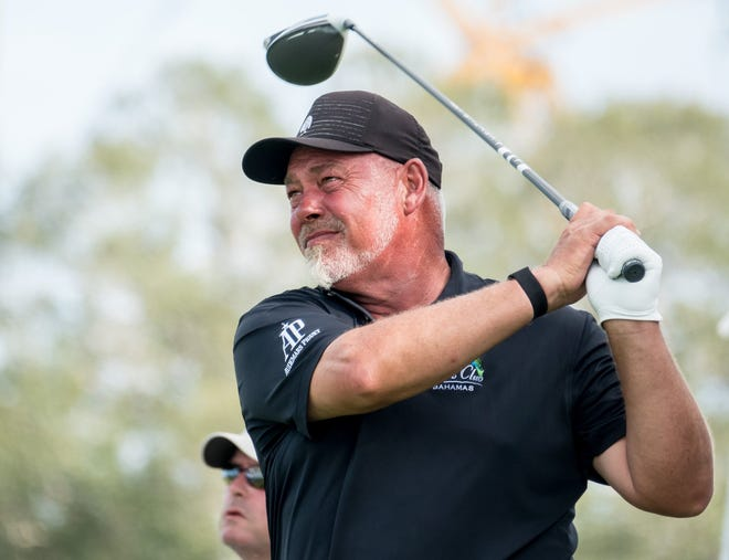 Darren Clarke, hitting a drive off the 12th tee Sunday, won the TimberTech Championship by one stroke over Bernhard Langer and Jim Furyk.