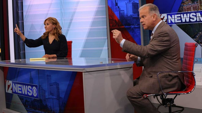 Republican challenger Barbara Ann Fenton-Fung and Democratic House Speaker Nicholas Mattiello debate last month on WPRI. Whichever candidate wins will have major ramifications at the State House.
