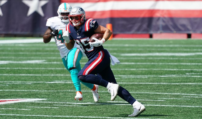 Published Caption:  Patriots tight end Ryan Izzo runs with the ball against the Miami Dolphins Sept. 13 at Gillette Stadium.