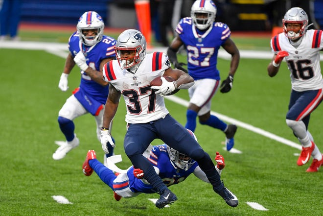 New England Patriots running back Damien Harris (37) breaks a tackle by Buffalo Bills' Dean Marlowe (31) during the second half of an NFL football game Sunday, Nov. 1, 2020, in Orchard Park, N.Y. Harris went on to score a touchdown on the play