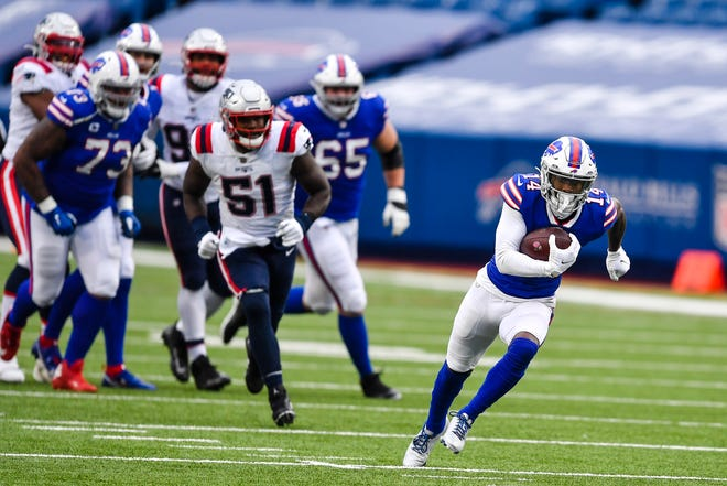 Buffalo Bills wide receiver Stefon Diggs (14) runs after making a catch during the second half of an NFL football game against the New England Patriots Sunday, Nov. 1, 2020, in Orchard Park, N.Y.
